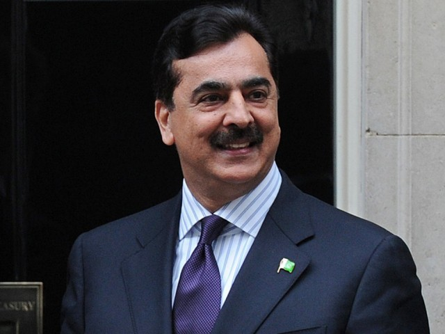 Prime Minister Yousaf Raza Gilani poses for pictures after a meeting at 10 Downing Street, London, on May 10, 2012. PHOTO: AFP