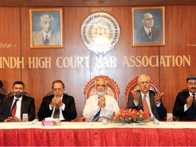 From left to right, Mohammad Ramzan of Income Tax Bar, Pakistan Bar Council's vice president Akhtar Hussain, Sindh Chief Justice Mushir Alam, SHCBA president Anwar Mansoor Khan and Salahuddin Gandapur. PHOTO: IRFAN ALI/EXPRESS