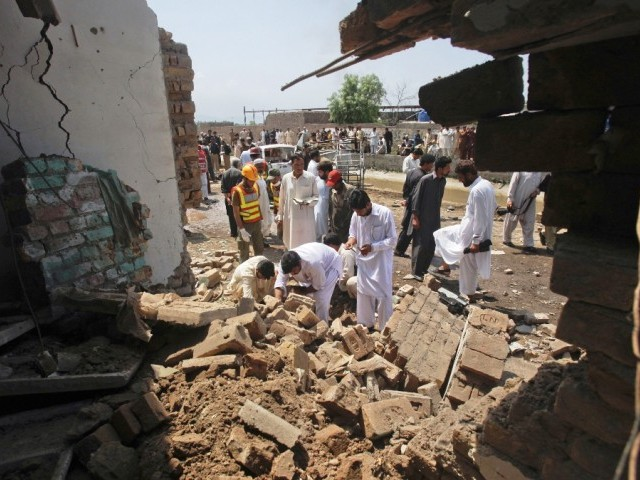 Blast destroyed outer wall of the check post and two vehicles, passing nearby during the blast. PHOTO: REUTERS
