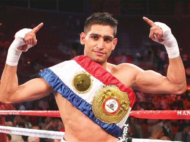 Despite being disappointed by the cancellation of his rematch against Lamont Peterson, Amir plans to improve the state of Pakistan boxing and prepare the local athletes boxers for the 2016 Olympics. PHOTO: AFP