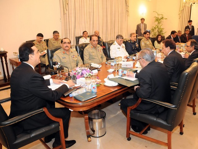 Pakistan's Prime Minister Yousuf Raza Gilani (L) chairing the defence committee meeting with senior cabinet ministers and military chiefs in Islamabad. PHOTO: PID