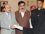 Sindh Chief Minister Syed Qaim Ali Shah distributed compensation cheques worth Rs0.2 million on Wednesday among the legal heirs of the victims of targeted killings in Karachi. PHOTO: NNI