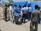 Security officials gather near the wreckage of a Pakistan Air Force Mushshak aircraft after it crashed in Rashakai in northwest Pakistan May 17, 2012.  PHOTO: MUHAMMED IQBAL/ THE EXPRESS TRIBUNE