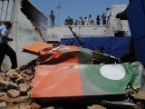 One of the two-seater propeller Mushshak planes crashed on a house, injuring a girl and an elderly man, and the second fell in nearby fields in the Rashkai area. PHOTO: MUHAMMED IQBAL/ THE EXPRESS TRIBUNE