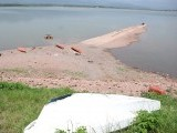 Old broken boats are seen strewn across the bank of Rawal Lake. PHOTO: INP