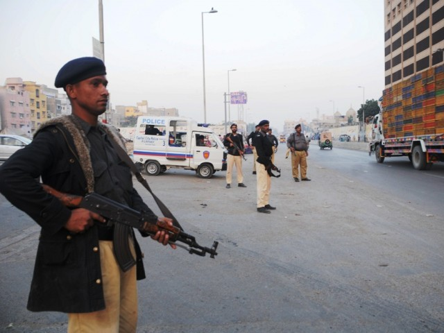 Two police officials have been killed due to violence in different areas of Karachi. PHOTO: EXPRESS/FILE