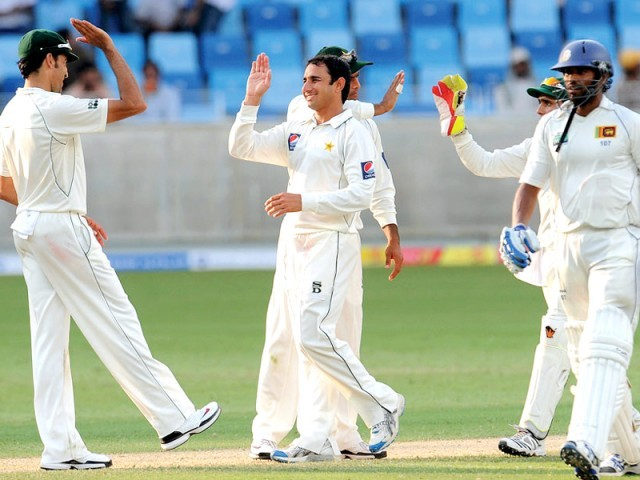 Saeed Ajmal has made it clear that he wants to bag all the man-of-the-match awards in the Test series and become the number one bowler in the format as Pakistan gear up for the Sri Lanka tour. PHOTO: AFP