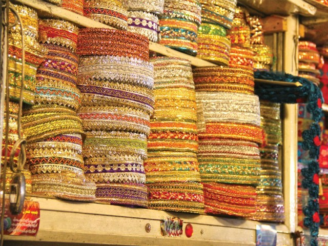 If you don't want to buy a ready-made outfit, you can also find all sorts of laces and gota at the market. PHOTO: AYESHA MIR/EXPRESS