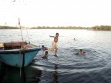 A child jumps from a boat to join his friends swimming in the cool water.  PHOTO: PPI