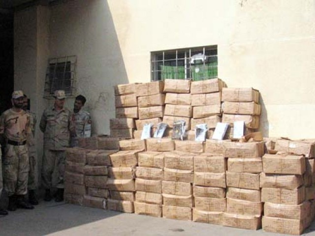 Sindh Police SIU, ANF found four tonnes of hashish hidden in sacks of coffee beans and sugar. PHOTO: PPI