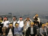 People watch an annual solar eclipse at a rooftop of Roppongi Hills complex in Tokyo May 21, 2012. The sun and moon aligned over the earth in a rare astronomical event - an annular eclipse that will dim the skies over parts of Asia and North America, briefly turning the sun into a blazing ring of fire. PHOTO: REUTERS