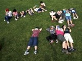 School children using solar viewers lie down on a lawn as they observe an annular eclipse at Hirai Daini Elementary School in Tokyo May 21, 2012. The sun and moon will align over the earth in a rare astronomical event - an annular eclipse that will dim the skies over parts of Asia and North America, briefly turning the sun into a blazing ring of fire. PHOTO: REUTERS