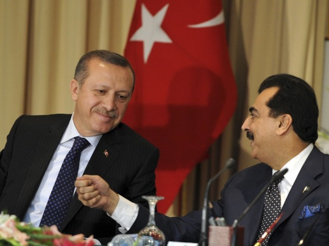 Turkish Prime Minister Recep Tayyip Erdogan (L) and his Pakistani counterpart Yousuf Raza Gilani interact during a joint press conference at The Prime Minister's House in Islamabad on May 22, 2012. Erdogan arrived in Pakistan on a three-day official visit to meet with Pakistani leaders. PHOTO: AFP