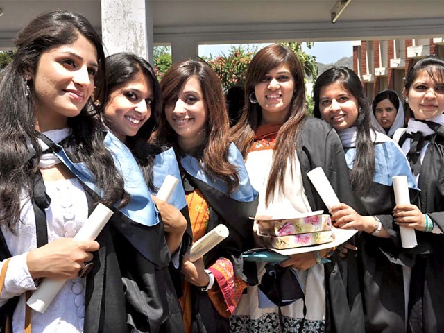 Students of IMCG pose with their degrees at the convocation on Tuesday. PHOTO: THE EXPRESS TRIBUNE