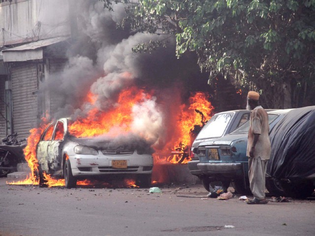 Arsonists went on a rampage following an attack on Awami Tehreek's rally. PHOTO: PPI