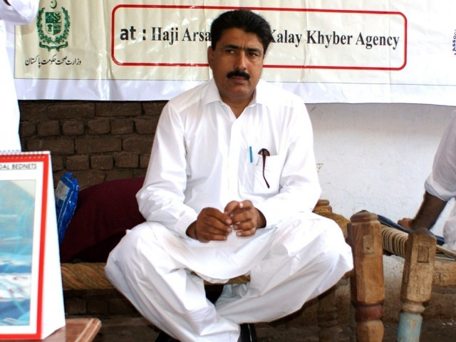 This photograph taken on July 22, 2010, shows Pakistani surgeon Shakeel Afridi, who was working for CIA to help find Osama bin Laden, attending a Malaria control campaign in Khyber tribal district.  PHOTO: AFP