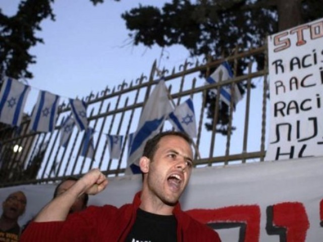 An Israeli protester chants slogans against racism and the government's policy regarding African migrants. PHOTO: AFP