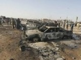 iraqi-soldiers-inspect-the-wreckage-of-vehicles-at-the-scene-of-a-car-bomb-attack-in-the-holy-city-of-kerbala-2