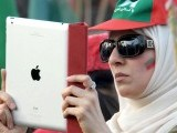 A PTI supporter recording the rally proceedings on her iPad. PHOTO: INP