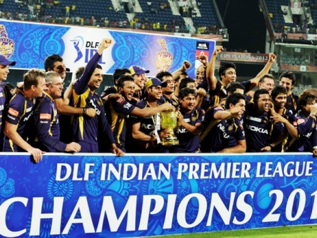 Kolkata Knight Riders cricketers, support staffs and officials celebrate with the DLF IPL trophy. PHOTO: AFP