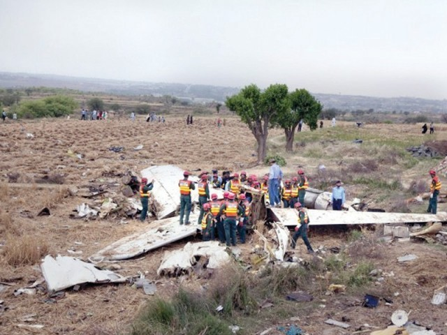 Wreckage of the Bhoja Air flight spread across the field. PHOTO: FILE