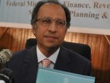 "Finance Minister Abdul Hafeez Shaikh holds a copy of the ""Pakistan Economic Survey 2011-12"" report during a press conference in Islamabad on May 31, 2012. PHOTO: AFP"