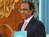 Federal Finance Minister Abdul Hafiz Sheikh shows the Pakistan Economic Survey Report 2011-2012 during a press conference on Thursday. PHOTO: MUHAMMAD JAVAID/ THE EXPRESS TRIBUNE