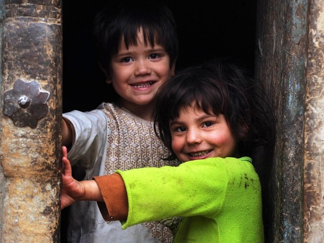 Afghan children pose for a picture. PHOTO: AFP