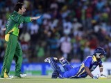 Pakistan's Saeed Ajmal (L) celebrates taking the wicket of Sri Lanka's Kaushal Lokuarachchi during their first Twenty-20 match, in Hambantota about 240km (149 miles) south of Colombo, June 1, 2012. PHOTO: REUTERS