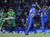 Sri Lanka's Lasith Malinga (R) celebrates taking the wicket of Pakistan's Umar Akmal (2nd L) during their first Twenty20 (T20) cricket match in Hambantota, about 240km (149 miles) south of Colombo June 1, 2012. PHOTO: REUTERS
