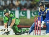 Afridi (L) plays a shot as wicketkeeper Kumar Sangakkara (R) looks on. PHOTO : AFP
