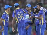Perera (C) celebrates with teammates after taking the wicket of Pakistan's Shoaib Malik. PHOTO : REUTERS