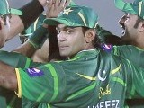 Hafeez (8) looks back as he celebrates. PHOTO : REUTERS