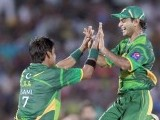 Hafeez (R) celebrates with Mohammad Sami after taking the wicket Kapugedera. PHOTO : REUTERS