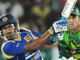 Chamara Kapugedera (L) plays a shot as wicketkeeper Shakeel Ansar (R) looks on. PHOTO : AFP