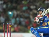 Dinesh Chandimal gets dismissed during the second and final Twenty20 match. PHOTO : AFP