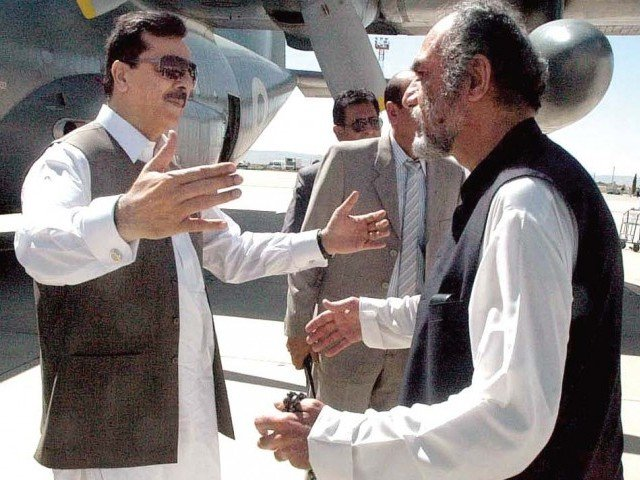 Balochistan Chief Minister Nawab Aslam Raisani receives Prime Minister Yousaf Raza Gilani upon his arrival at the Quetta airport. PHOTO: APP
