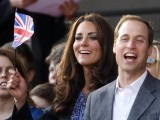 Britain's Catherine, Duchess of Cambridge waves a Union Flag as she watches with Prince William during the Diamond Jubilee concert in front of Buckingham Palace in London June 4, 2012.  PHOTO: REUTERS