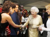 Queen Elizabeth II greets British singer Cheryl Cole (L) and Australian singer Kylie Minogue (R) backstage during the Diamond Jubilee Concert outside Buckingham Palace in London, on June 4, 2012. PHOTO: AFP