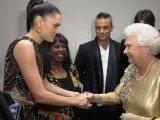 Queen Elizabeth II greets  British singer-songwriter Jessie J (L) and British singer Robbie Williams (C) backstage during the Diamond Jubilee Concert outside Buckingham Palace in London, on June 4, 2012. PHOTO: AFP