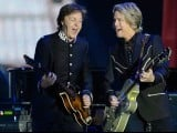 British singer Sir Paul McCartney (L) performs during the Queen's Diamond Jubilee Concert at Buckingham Palace in London on Juine 4, 2012. PHOTO: AFP