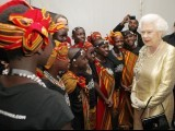 Queen Elizabeth meets dancers from Kenya backstage at the Diamond Jubilee Concert outside Buckingham Palace in London June 4 , 2012.  PHOTO: REUTERS
