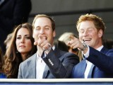 Princes William (C) and Harry (R) laugh as they sit with Catherine, Duchess of Cambridge during the Diamond Jubilee concert at Buckingham Palace in London June 4, 2012. PHOTO: REUTERS