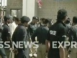 Police officials inspect the site of the blast in Quetta. PHOTO: EXPRESS