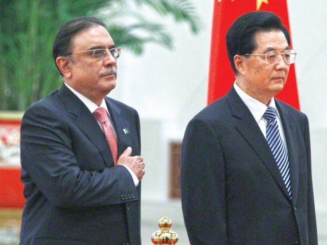 President Asif Ali Zardari listens to his national anthem with Chinese counterpart Hu Jintao during an official welcoming ceremony in Beijing on Thursday. PHOTO: REUTERS