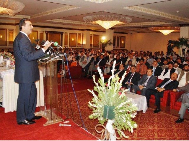 Prime Minister Yousaf Raza Gilani addressing a gathering at the inaugural ceremony of the International Gems and Jewelers in Karachi on Thursday. PHOTO: NNI