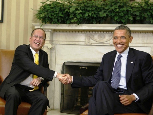 Aquino and Obama called for diplomacy to resolve territorial disputes 'without coercion or the use of force'. PHOTO: REUTERS