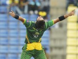Shahid Afridi celebrates taking the wicket of Sri Lanka's Dinesh Chandimal. PHOTO: REUTERS