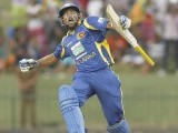 Tillakaratne Dilshan celebrates his century. PHOTO: REUTERS