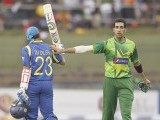 Sri Lanka's Tillakaratne Dilshan (L) celebrates his century as Pakistan's Umar Gul congratulates him during their second One Day International (ODI) cricket match, in Pallekele. PHOTO: REUTERS